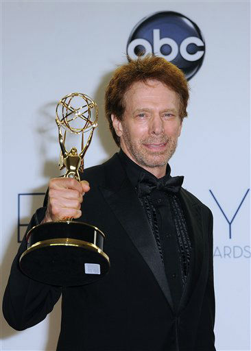 "<div class=""meta ""><span class=""caption-text "">erry Bruckheimer poses for a photo at The 64th Annual Primetime Emmy Awards Winners Walk, Sunday, September 23, 2012, at LA Live, in Los Angeles.64th Primetime Emmy® Awards air live coast-to-coast on Sunday, September 23rd on ABC from the Nokia Theatre L.A. LIVE in Los Angeles.</span></div>"