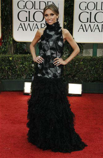 "<div class=""meta image-caption""><div class=""origin-logo origin-image ""><span></span></div><span class=""caption-text"">Guilana Rancic arrives at the 69th Annual Golden Globe Awards Sunday, Jan. 15, 2012, in Los Angeles. She is one of the celebrities rumored to be dancing on the 14th season of 'Dancing with the Stars' on ABC. The official cast will be revealed on February 28 on ABC. (AP Photo/ Matt Sayles)</span></div>"