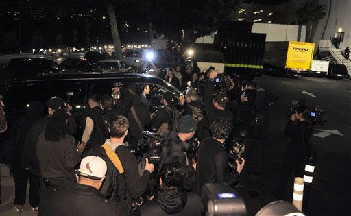 "<div class=""meta ""><span class=""caption-text "">A crowd gathers outside the loading dock at the Beverly Hilton Hotel Saturday Feb. 11, 2012 in Beverly Hills Calif. Whitney Houston, who ruled as pop music's queen until her majestic voice and regal image were ravaged by drug use, erratic behavior and a tumultuous marriage to singer Bobby Brown, died Saturday. She was 48.  (AP Photo/ Mark J. Terrill)</span></div>"