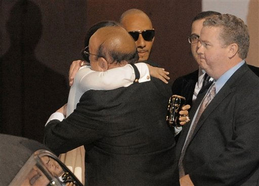 Alicia Keys hugs Clive Davis at the loading dock outside the Beverly Hilton Hotel Saturday Feb. 11, 2012 in Beverly Hills, Calif. Whitney Houston, who ruled as pop music&#39;s queen until her majestic voice and regal image were ravaged by drug use, erratic behavior and a tumultuous marriage to singer Bobby Brown, died Saturday. She was 48.  <span class=meta>(AP Photo&#47; Mark J. Terrill)</span>