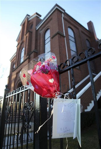 Flowers and a sympathy card hang on a fence in front of New Hope Baptist Church in Newark, N.J., early Sunday, Feb. 12, 2012. As a young girl, Whitney Houston sang in the choir at New Hope Baptist Church. Houston, who ruled as pop music&#39;s queen until her majestic voice and regal image were ravaged by drug use, erratic behavior and a tumultuous marriage to singer Bobby Brown, died Saturday. She was 48.   <span class=meta>(AP Photo&#47; Mel Evans)</span>