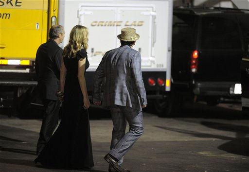 Elvis Costello right, and Diana Krall are seen outside the back entrance to the Beverly Hilton Hotel Saturday Feb. 11, 2012 in Beverly Hills Calif. Whitney Houston, who ruled as pop music&#39;s queen until her majestic voice and regal image were ravaged by drug use, erratic behavior and a tumultuous marriage to singer Bobby Brown, died Saturday. She was 48. <span class=meta>(AP Photo&#47; Mark J. Terrill)</span>