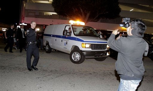 "<div class=""meta ""><span class=""caption-text "">The body of Whitney Houston is removed from the Beverly Hilton Hotel Saturday Feb. 11, 2012 in Beverly Hills Calif. Whitney Houston, who ruled as pop music's queen until her majestic voice and regal image were ravaged by drug use, erratic behavior and a tumultuous marriage to singer Bobby Brown, died Saturday. She was 48.  (AP Photo/ Jae C. Hong)</span></div>"