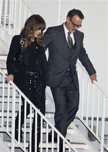 Actor Tom Hanks and his wife Rita Wilson leave the Pre-GRAMMY Gala at the backdoor of the Beverly Hills Hilton hotel in Beverly Hills, Calif. Saturday, Feb. 11, 2012. Whitney Houston was pronounced dead at 3:55 p.m. in her room on the fourth floor of the hotel on Saturday. She was 48. <span class=meta>(AP Photo&#47; Bret Hartman)</span>
