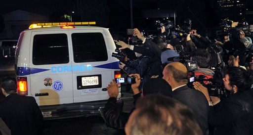 "<div class=""meta ""><span class=""caption-text "">Media mobs a coroner's van as it leaves the Beverly Hilton Hotel, early Sunday, Feb. 12, 2012, in Beverly Hills, Calif. Whitney Houston, who ruled as pop music's queen until her majestic voice and regal image were ravaged by drug use, erratic behavior and a tumultuous marriage to singer Bobby Brown, died Saturday. She was 48.   (AP Photo/ Mark J. Terrill)</span></div>"