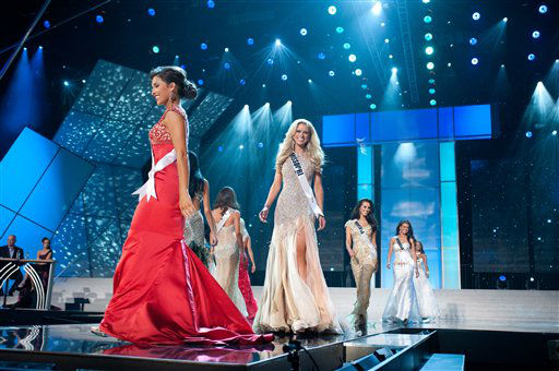 Walking the runway are Miss Mississippi USA 2012, Myverick Rashea Garcia, at left in Red; Miss Missouri USA 2012, Katie Kearney; Miss Montana USA 2012, Autumn Marie Muller; and Miss Nebraska USA 2012, Amy Spilker competing in her choice evening gown during the 2012 Miss USA Presentation Show on Wednesday, May 30, 2012 in Las Vegas, Nevada. The 2012 MISS USA Pageant will air LIVE on NBC June 3 at 9:00 p.m. EDT.&#40;AP Photo&#47;Darren Decker, Miss Universe Organization&#41; <span class=meta>(AP Photo&#47; Darren Decker)</span>