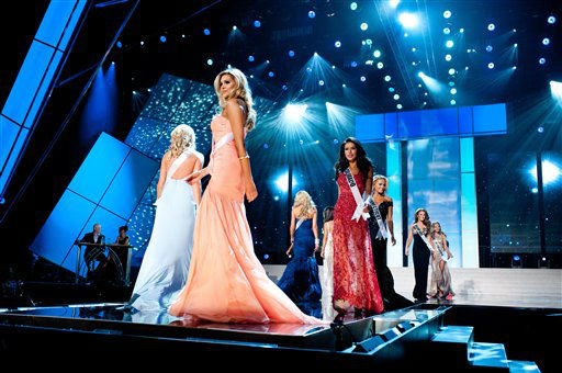 Walking the runway are Miss Colorado USA 2012, Marybel Gonzalez, in red; Miss Connecticut USA 2012, Marie-Lynn Piscitelli; Miss Delaware USA 2012, Krista Clausen; Miss District Of Columbia USA 2012, Monique LaShone Thompkins; and Miss Florida USA 2012, Karina Brez;  competing in their choice evening gowns during the 2012 Miss USA Presentation Show on Wednesday, May 30, 2012 in Las Vegas, Nevada. The 2012 MISS USA Pageant will air LIVE on NBC June 3 at 9:00 p.m. EDT. &#40;AP Photo&#47;Darren Decker, Miss Universe Organization&#41; <span class=meta>(AP Photo&#47; Darren Decker)</span>