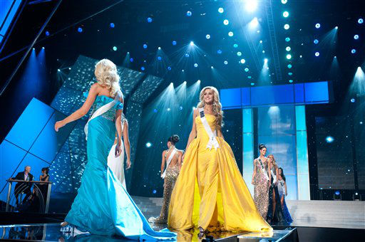 Walking the runway from left are Miss Ohio USA 2012, Audrey Bolte, in yellow; Miss Oklahoma USA 2012, Lauren Taylor Lundeen; Miss Oregon USA 2012, Alaina Bergsma; and Miss Pennsylvania USA 2012, Sheena Monnin competing in their choice of evening gowns during the 2012 Miss USA Presentation Show on Wednesday, May 30, 2012 in Las Vegas, Nevada. The 2012 MISS USA Pageant will air LIVE on NBC June 3 at 9:00 p.m. EDT. &#40;AP Photo&#47;Darren Decker, Miss Universe Organization&#41; <span class=meta>(AP Photo&#47; Darren Decker)</span>
