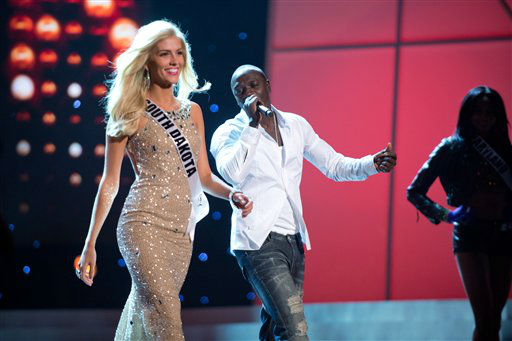 Akon rehearses his new hit single &#34;America&#39;s Most Wanted&#34; during a Dress Rehearsal for the 2012 MISS USA&reg; Competition along with Miss South Dakota USA 2012, Taylor Neisen on Friday June 1, 2012 in Las Vegas, Nevada.  The 51 Miss USA 2012 Contestants will compete for the coveted Crown Sunday June 3, 2012. &#40;AP Photo&#47;Miss Universe Organization&#41; <span class=meta>(AP Photo&#47; Darren Decker)</span>