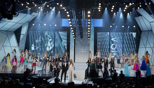 Andy Cohen, center left, and Giuliana Rancic open the 2012 Miss USA pageant, Sunday, June 3, 2012, in Las Vegas. &#40;AP Photo&#47;Julie Jacobson&#41; <span class=meta>(AP Photo&#47; Julie Jacobson)</span>