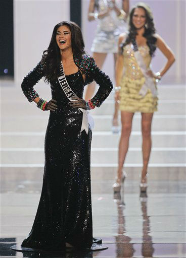 "<div class=""meta ""><span class=""caption-text "">Miss New Jersey Michelle Leonardo, left, reacts as she is announced as one of the 16 finalists during the 2012 Miss USA pageant, Sunday, June 3, 2012, in Las Vegas. (AP Photo/Julie Jacobson) (AP Photo/ Julie Jacobson)</span></div>"