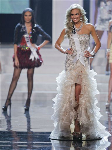 "<div class=""meta ""><span class=""caption-text "">Miss Texas Brittany Booker, right, walks along the stage after being announced as one of the 16 finalists during the 2012 Miss USA pageant, Sunday, June 3, 2012, in Las Vegas. (AP Photo/Julie Jacobson) (AP Photo/ Julie Jacobson)</span></div>"