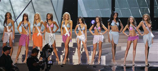 "<div class=""meta ""><span class=""caption-text "">The ten Miss USA finalists pose on stage during the 2012 Miss USA pageant, Sunday, June 3, 2012, in Las Vegas. (AP Photo/Julie Jacobson) (AP Photo/ Julie Jacobson)</span></div>"
