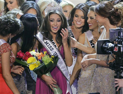 "<div class=""meta image-caption""><div class=""origin-logo origin-image ""><span></span></div><span class=""caption-text"">Miss Rhode Island Olivia Culpo, center, is surrounded by fellow contestants after being crowned Miss USA during the 2012 Miss USA pageant, Sunday, June 3, 2012, in Las Vegas. (AP Photo/Julie Jacobson) (AP Photo/ Julie Jacobson)</span></div>"