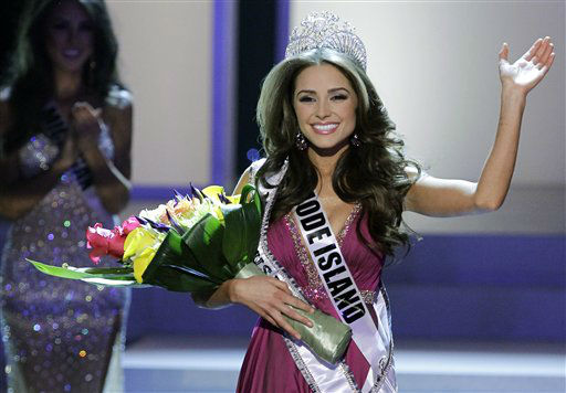"<div class=""meta image-caption""><div class=""origin-logo origin-image ""><span></span></div><span class=""caption-text"">Miss Rhode Island Olivia Culpo waves to the audience after being crowned Miss USA during the 2012 Miss USA pageant, Sunday, June 3, 2012, in Las Vegas. (AP Photo/Julie Jacobson) (AP Photo/ Julie Jacobson)</span></div>"