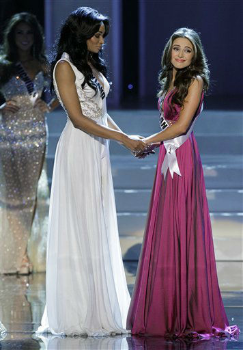Miss Rhode Island Olivia Culpo, right, holds hands with Miss Maryland Nana Meriwether as they wait for the announcement of the winner of Miss USA during the 2012 Miss USA pageant, Sunday, June 3, 2012, in Las Vegas. Culpo was announced the winner. &#40;AP Photo&#47;Julie Jacobson&#41; <span class=meta>(AP Photo&#47; Julie Jacobson)</span>