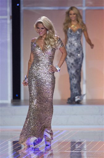 Miss Kansas Gentry Miller walks out on stage during the opening number for the 2012 Miss USA pageant, Sunday, June 3, 2012, in Las Vegas. &#40;AP Photo&#47;Julie Jacobson&#41; <span class=meta>(AP Photo&#47; Julie Jacobson)</span>