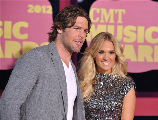 Mike Fisher, left, and singer Carrie Underwood arrive at the 2012 CMT Music Awards on Wednesday, June 6, 2012 in Nashville, Tenn. &#40;Photo by John Shearer&#47;Invision&#47;AP&#41; <span class=meta>(Photo&#47;John Shearer)</span>