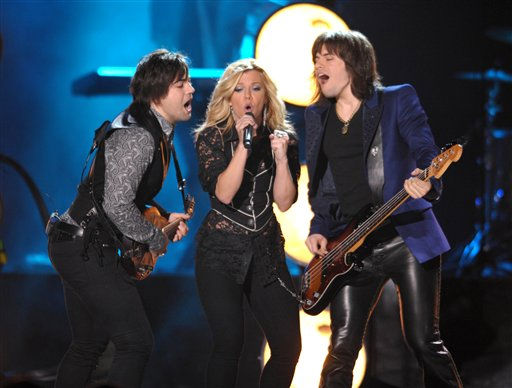 From left, Neil Perry, Kimberly Perry and Reid Perry of The Band Perry perform at the 2012 CMT Music Awards on Wednesday, June 6, 2012 in Nashville, Tenn. &#40;Photo by John Shearer&#47;Invision&#47;AP&#41; <span class=meta>(Photo&#47;John Shearer)</span>