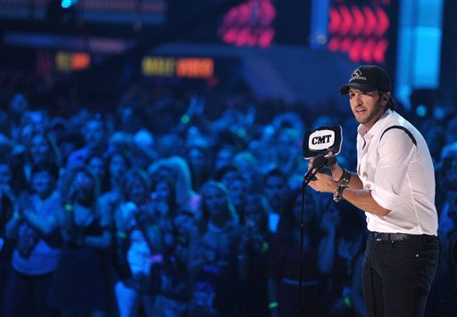 Luke Bryan accepts the award for Male Video Of The Year at the 2012 CMT Music Awards on Wednesday, June 6, 2012 in Nashville, Tenn. &#40;Photo by John Shearer&#47;Invision&#47;AP&#41; <span class=meta>(Photo&#47;John Shearer)</span>