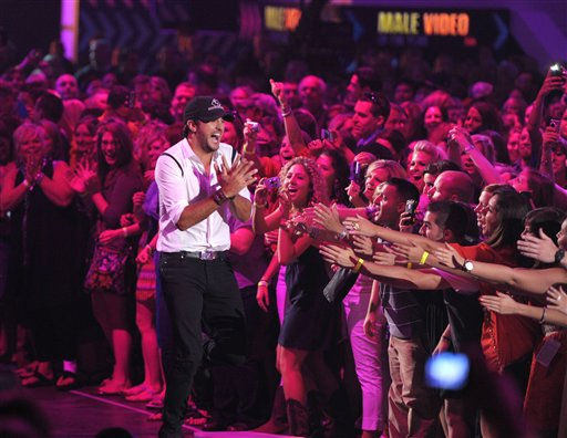 Luke Bryan reacts to winning the award for Male Video Of The Year at the 2012 CMT Music Awards on Wednesday, June 6, 2012 in Nashville, Tenn. &#40;Photo by John Shearer&#47;Invision&#47;AP&#41; <span class=meta>(Photo&#47;John Shearer)</span>