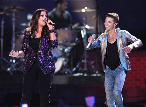 Hillary Scott, left, of Lady Antebellum and Arnel Pineda of Journey perform at the 2012 CMT Music Awards on Wednesday, June 6, 2012 in Nashville, Tenn. &#40;Photo by John Shearer&#47;Invision&#47;AP&#41; <span class=meta>(Photo&#47;John Shearer)</span>