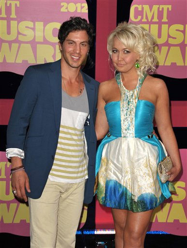 Joshua Scott Jones, left, and Meghan Linsey of Steel Magnolia arrive at the 2012 CMT Music Awards on Wednesday, June 6, 2012 in Nashville, Tenn.