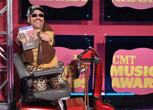 "<div class=""meta ""><span class=""caption-text ""> Two foot Fred arrives at the 2012 CMT Music Awards on Wednesday, June 6, 2012 in Nashville, Tenn. (Photo by John Shearer/Invision/AP)</span></div>"