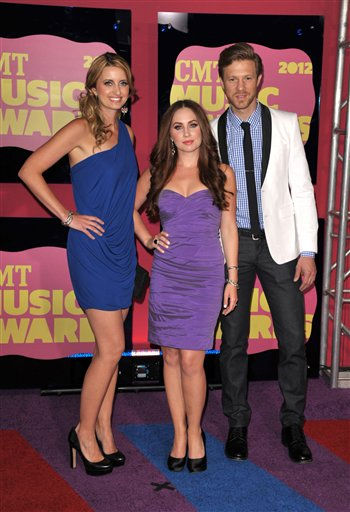 From left, Musicians Cherill Green, Hannah Blaylock and Dean Berner of Edens Edge arrive at the 2012 CMT Music Awards on Wednesday, June 6, 2012 in Nashville, Tenn. (Photo by John Shearer/Invision/AP)