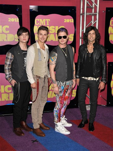 "<div class=""meta image-caption""><div class=""origin-logo origin-image ""><span></span></div><span class=""caption-text"">From left, Musicians Jamie Follese, Ryan Follese, Nash Overstreet and Ian Keaggy of Hot Chelle Rae arrive at the 2012 CMT Music Awards on Wednesday, June 6, 2012 in Nashville, Tenn.</span></div>"
