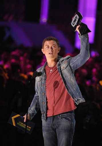 "<div class=""meta ""><span class=""caption-text "">Scotty McCreery accepts the award for USA Weekend Breakthrough Video Of The Year at the 2012 CMT Music Awards on Wednesday, June 6, 2012 in Nashville, Tenn. </span></div>"