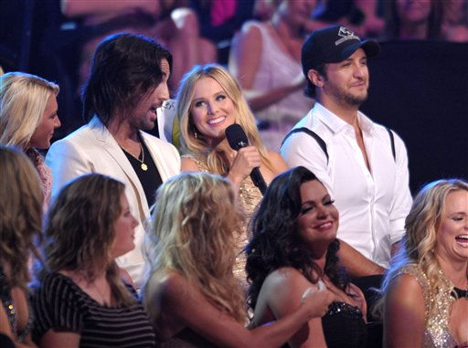 From left, Jake Owen, Kristen Bell and Luke Bryan appear in the audience at the 2012 CMT Music Awards on Wednesday, June 6, 2012 in Nashville, Tenn.