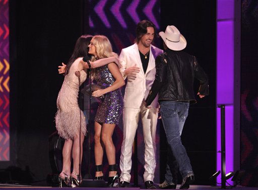 Singer Carrie Underwood and musician Brad Paisley, right, accept the award for Collaborative Video Of The Year presented by actress Ashley Greene, left, and Jake Owen at the 2012 CMT Music Awards on Wednesday, June 6, 2012 in Nashville, Tenn.