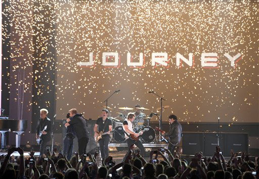 Arnel Pineda, left, of Journey, Gary LeVox, Jay DeMarcus and Joe Don Rooney of Rascal Flatts perform at the 2012 CMT Music Awards on Wednesday, June 6, 2012 in Nashville, Tenn.