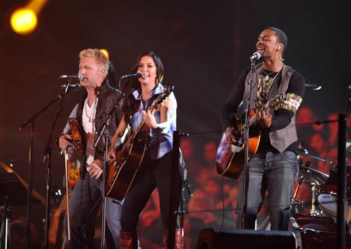 "<div class=""meta image-caption""><div class=""origin-logo origin-image ""><span></span></div><span class=""caption-text"">From left, Nick Hoffman, Krista Marie, and Damien Horne of The Farm perform at the 2012 CMT Music Awards on Wednesday, June 6, 2012 in Nashville, Tenn. </span></div>"