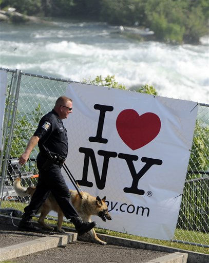A security officer sweeps the perimeter before Nik Wallenda&#39;s walk across Niagara Falls on a wire in Niagara Falls, N.Y., Friday, June 15, 2012. Wallenda will attempt what nobody has done before: A high wire walk directly over the precipice at Niagara Falls and 190 feet &#40;58 meters&#41; above the churning torrent below.  &#40;AP Photo&#47;Gary Wiepert&#41; <span class=meta>(AP Photo&#47; Gary Wiepert)</span>