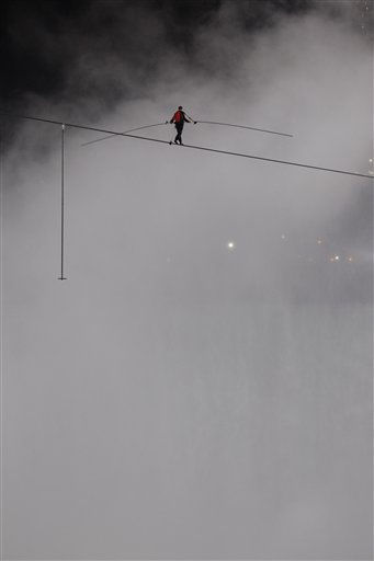 "<div class=""meta image-caption""><div class=""origin-logo origin-image ""><span></span></div><span class=""caption-text"">Nik Wallenda walks across Niagara Falls on a wire in Niagara Falls, N.Y., Friday, June 15, 2012. Wallenda has finished his attempt to become the first person to walk on a tightrope 1,800 feet across the mist-fogged brink of roaring Niagara Falls. The seventh-generation member of the famed Flying Wallendas had long dreamed of pulling off the stunt, never before attempted. (AP Photo/David Duprey) (AP Photo/ David Duprey)</span></div>"