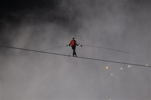"<div class=""meta image-caption""><div class=""origin-logo origin-image ""><span></span></div><span class=""caption-text"">Nik Wallenda walks across Niagara Falls on a tightrope as seen from Niagara Falls, N.Y., Friday, June 15, 2012. Wallenda has finished his attempt to become the first person to walk on a tightrope 1,800 feet across the mist-fogged brink of roaring Niagara Falls. The seventh-generation member of the famed Flying Wallendas had long dreamed of pulling off the stunt, never before attempted. (AP Photo/David Duprey) (AP Photo/ David Duprey)</span></div>"