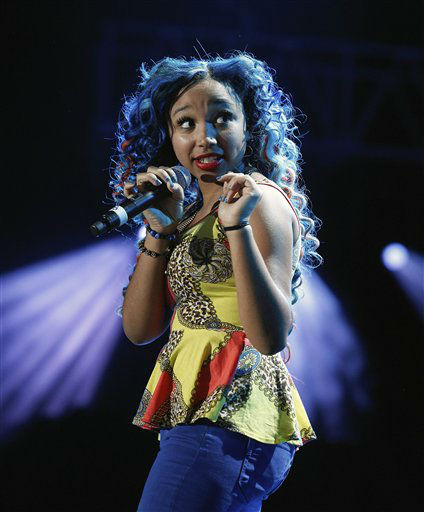 Breaunna Womack, known as Baby Doll of The OMG Girls, performs at the Essence Music Festival in New Orleans, Thursday, July 5, 2012. This is the first day of the four day music festival. &#40;Photo by Bill Haber&#47;Invision&#47;AP&#41; <span class=meta>(Photo&#47;Bill Haber)</span>