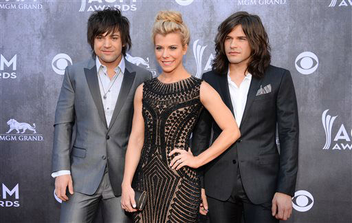 Neil Perry, and from left, Kimberly Perry and Reid Perry, of the musical group The Band Perry, arrive at the 49th annual Academy of Country Music Awards at the MGM Grand Garden Arena on Sunday, April 6, 2014, in Las Vegas. &#40;Photo by Al Powers&#47;Powers Imagery&#47;Invision&#47;AP&#41; <span class=meta>(Al Powers&#47;Powers Imagery)</span>