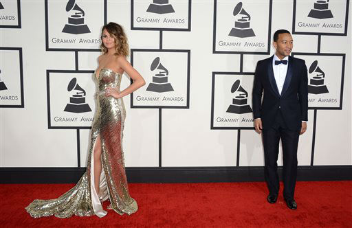 Christine Teigen, left, and John Legend arrive at the 56th annual Grammy Awards at Staples Center on Sunday, Jan. 26, 2014, in Los Angeles.   <span class=meta>(Photo&#47;Jordan Strauss)</span>