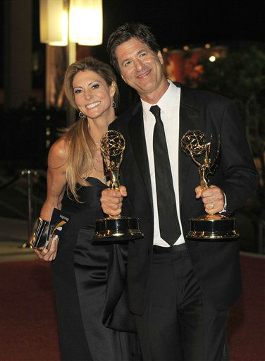 Steven Levitan, right, and Krista Levitan pose with the awards for outstanding comedy series and outstanding directing in a comedy series for &#34;Modern Family&#34; as they arrive at the 64th Primetime Emmy Awards Governors Ball on Sunday, Sept. 23, 2012, in Los Angeles. &#40;Photo by Chris Pizzello&#47;Invision&#47;AP&#41; <span class=meta>(Photo&#47;Chris Pizzello)</span>
