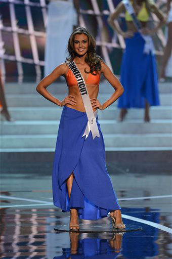 "<div class=""meta ""><span class=""caption-text "">Miss Connecticut Erin Brady walks the runway during the swimsuit competition of the Miss USA 2013 pageant, Sunday, June 16, 2013, in Las Vegas. Erin Brady of South Glastonbury, Conn., won the beauty pageant.    (AP Photo/ Jeff Bottari)</span></div>"