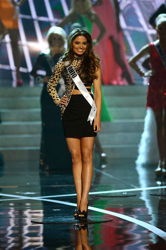 "<div class=""meta ""><span class=""caption-text "">Miss Ohio Kristin Smith from Dayton walks the runway during the introductions of the Miss USA 2013 pageant, Sunday, June 16, 2013, in Las Vegas. (AP Photo/ Jeff Bottari)</span></div>"