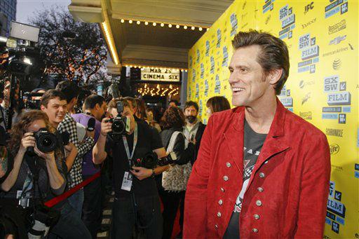 In this photo provided by Warner Bros., Jim Carrey arrives at the world premiere of New Line Cinema&#39;s &#34;The Incredible Burt Wonderstone&#34;, a Warner Bros. Pictures release, on the opening night of the SXSW Film Festival on Friday, March 8, 2013 in Austin, Texas.   <span class=meta>(AP Photo&#47; Jack Plunkett)</span>