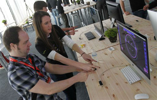 LeapMotion marketing manager Julia Parson assists Justin Davis in using her company&#39;s 3D motion control during the SXSW Interactive Festival, Saturday, March 9, 2013 in Austin, Texas.   <span class=meta>(AP Photo&#47; Jack Plunkett)</span>