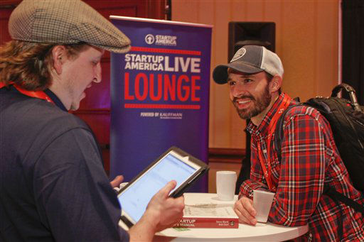 Tech entrepreneurs Barron Gillon, left, and Sheldon Grizzle discuss their idea at the Startup Village during the SXSW Interactive Festival on Saturday, March 9, 2013 in Austin, Texas.  <span class=meta>(AP Photo&#47; Jack Plunkett)</span>