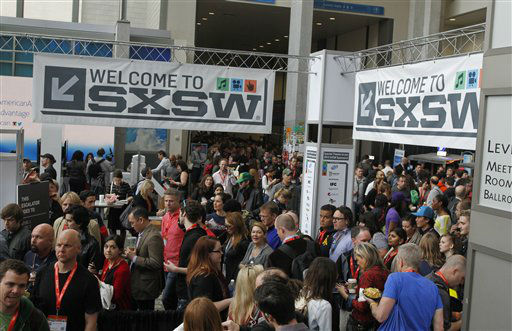 SXSW Interactive and Film Festival attendees crowd the Austin Convention Center, Saturday, March 9, 2013 in Austin, Texas.  <span class=meta>(AP Photo&#47; Jack Plunkett)</span>