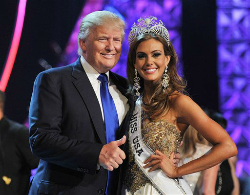 From left, Donald Trump and Miss Connecticut USA Erin Brady pose onstage after Brady won the 2013 Miss USA pageant, Sunday, June 16, 2013, in Las Vegas.   <span class=meta>(Photo&#47;Jeff Bottari)</span>