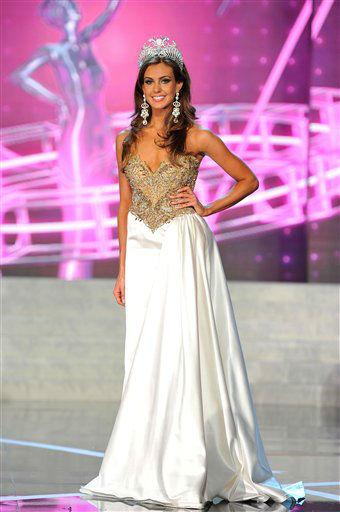 "<div class=""meta ""><span class=""caption-text "">Miss Connecticut USA Erin Brady poses onstage after Brady won the 2013 Miss USA pageant, Sunday, June 16, 2013, in Las Vegas.  (Photo/Jeff Bottari)</span></div>"
